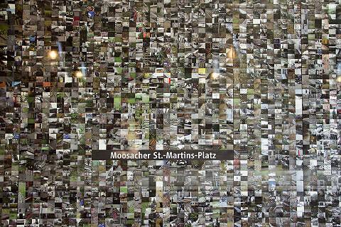 Hintergleiswand am Moosacher St.-Martins-Platz mit Bildern von Masayuki Akiyoshi